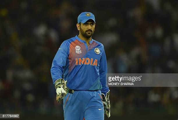 India's captain Mahendra Singh Dhoni walks off the pitch after the end of the Australian innings during the World T20 cricket tournament match...