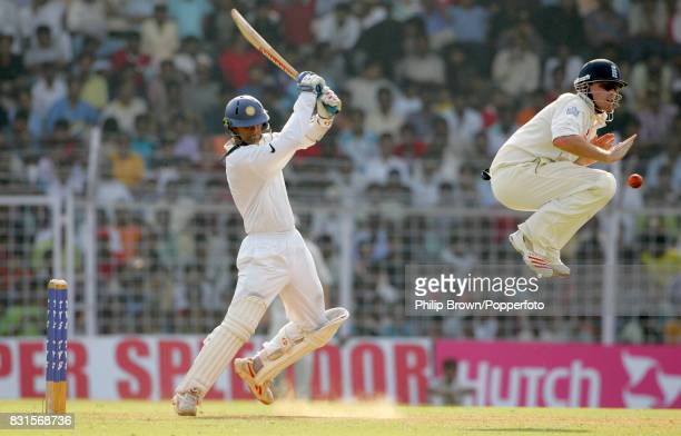 India's captain Rahul Dravid drives the ball past a leaping Ian Bell of England during the 3rd Test match between India and England at the Wankhede...