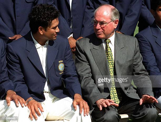 India's captain Sachin Tendulkar chats with Australian Prime Minister John Howard during the official team photograph before the start of the match...