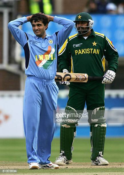 India's Captain Sourav Ganguly holds his head after bowling as Inzamam ulHaq of Pakistan looks on during the ICC Championship Trophy match at...