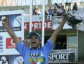 India's captain Sourav Ganguly jubilates as he lifts the Natwest Trophy 13 July 2002 at Lord's in London after India beat England in a triangular...