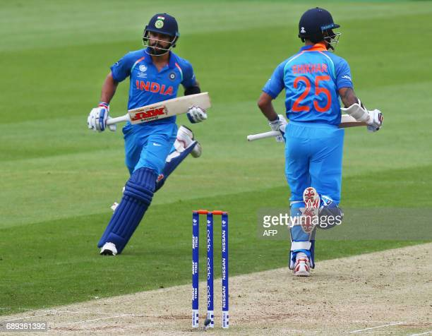 India's captain Virat Kohli and India's Shikhar Dhawan run between wickets during the ICC Champions Trophy Warmup match between India and New Zealand...