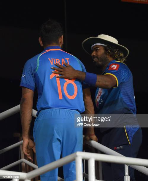 India's captain Virat Kohli and shares a moment with Sri Lanka's Lasith Malinga after India victory in the third one day international cricket match...