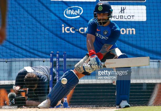 India's captain Virat Kohli attends a nets practice session at The Oval in London on June 17 on the eve of the ICC Champions Trophy Final cricket...