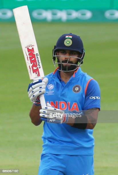 India's captain Virat Kohli celebrates his half century during the ICC Champions Trophy Warmup match between India and New Zealand at The Oval in...