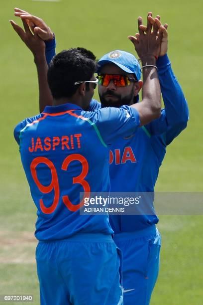 India's captain Virat Kohli celebrates with India's Jasprit Bumrah after he runsout Pakistan's Azhar Ali during the ICC Champions Trophy final...
