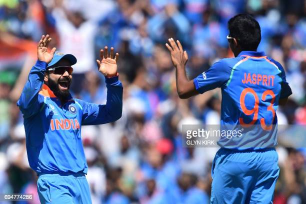 India's captain Virat Kohli celebrates with India's Jasprit Bumrah South Africa's David Miller for one during the ICC Champions Trophy match between...