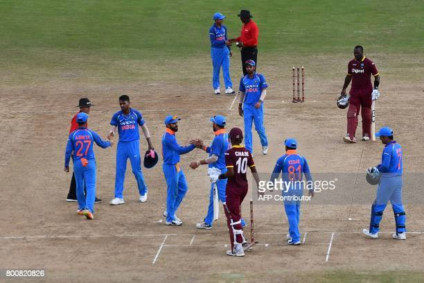 India's captain Virat Kohli celebrates with teammate at the end of the second One Day International match between West Indies and India at the...