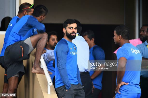 India's captain Virat Kohli chats with West Indies' Kieran Powell before the start of the second One Day International match between West Indies and...
