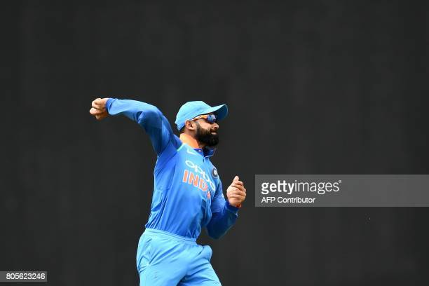 TOPSHOT India's captain Virat Kohli fields the ball during the fourth One Day International match between West Indies and India at the Sir Vivian...