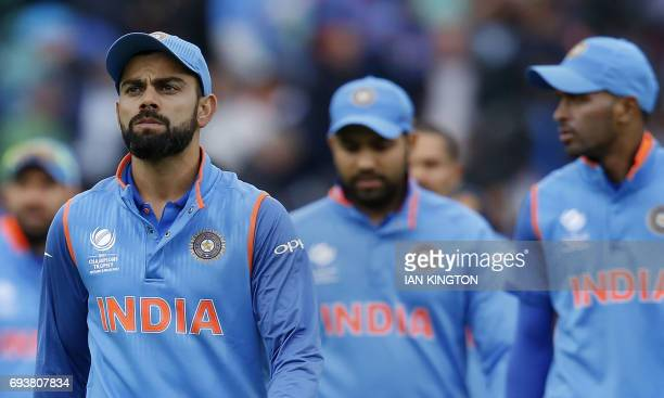 Indias captain Virat Kohli leads his team off the field as Sri Lanka win by seven wickets with eight balls remaining at the end of the ICC Champions...