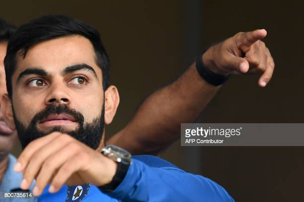 India's captain Virat Kohli looks at the wet ground before the start of the second One Day International match between West Indies and India at the...