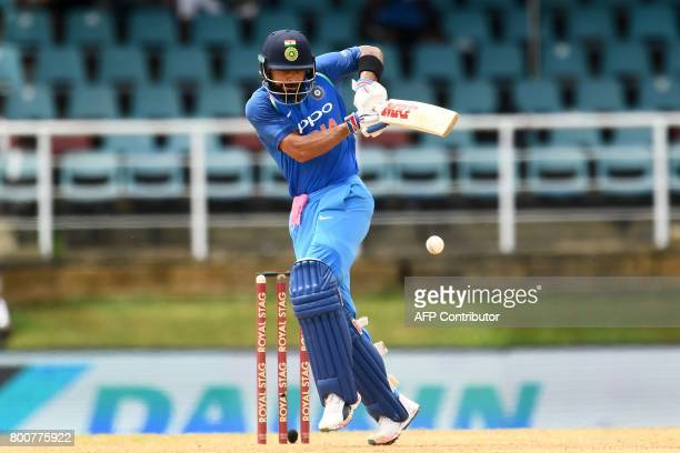 India's captain Virat Kohli plays a sho tduring the second One Day International match between West Indies and India at the Queen's Park Oval in Port...