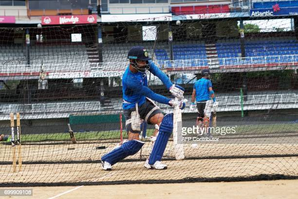 India's captain Virat Kohli plays a shot during a practice session at the Queen's Park Oval in Port of Spain Trinidad on June 22 ahead of the first...