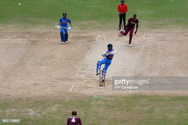 India's captain Virat Kohli plays a shot during the first One Day International match between West Indies and India at the Queen's Park Oval in Port...