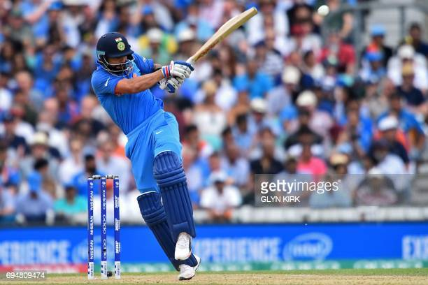 India's captain Virat Kohli plays a shot during the ICC Champions Trophy match between South Africa and India at The Oval in London on June 11 2017...