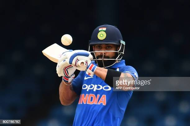 India's captain Virat Kohli plays a shot during the second One Day International match between West Indies and India at the Queen's Park Oval in Port...