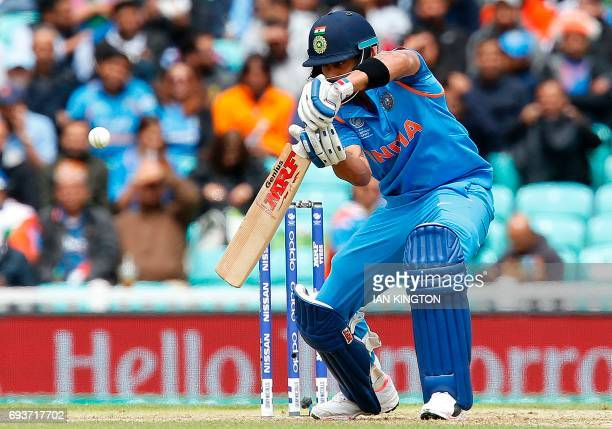 India's captain Virat Kohli plays a shot to be caught out for 0 runs by Sri Lanka's Niroshan Dickwella during the ICC Champions Trophy match between...