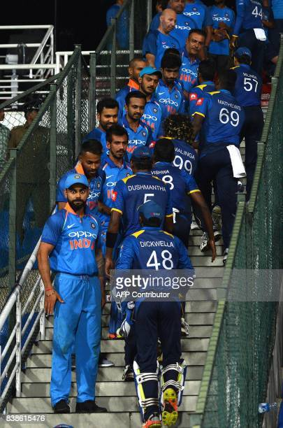 India's captain Virat Kohli reacts as he greets Sri Lanka's players after India's victory in the second one day international cricket match between...