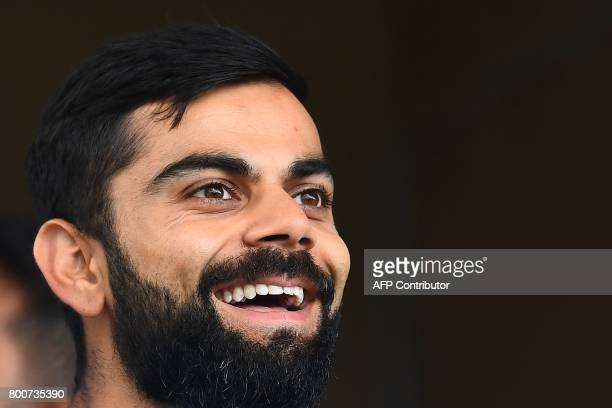 India's captain Virat Kohli smiles before the start of the second One Day International match between West Indies and India at the Queen's Park Oval...