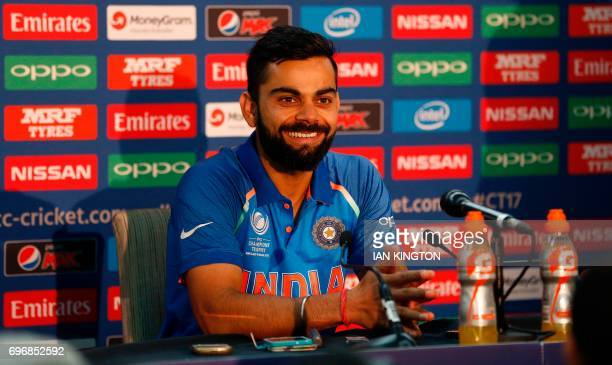 India's captain Virat Kohli speaks during a press conference folling a nets practice session at The Oval in London on June 17 on the eve of the ICC...