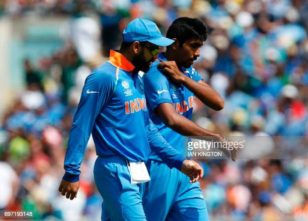 India's captain Virat Kohli talks with India's Jasprit Bumrah during the ICC Champions Trophy final cricket match between India and Pakistan at The...