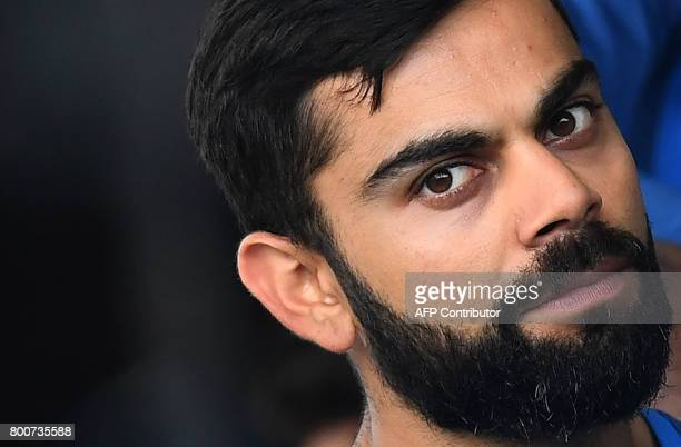 India's captain Virat Kohli talks with teammates before the start of the second One Day International match between West Indies and India at the...
