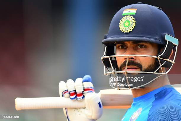 India's captain Virat Kohli waits to bat during a practice session at the Queen's Park Oval in Port of Spain Trinidad on June 22 ahead of the first...