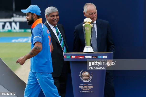 India's captain Virat Kohli walks past the trophy during the presentation after the ICC Champions Trophy final cricket match between India and...