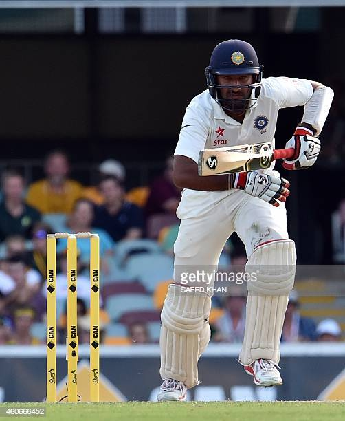 India's Cheteshwar Pujara takes a quick single during the third day of the 2nd cricket Test match between Australia and India at Gabba in Brisbane on...