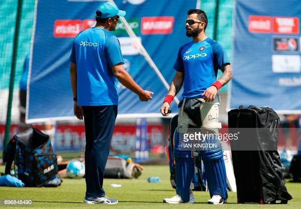 India's coach Anil Kumble talks with India's captain Virat Kohli during a nets practice session at The Oval in London on June 17 on the eve of the...