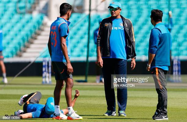 India's coach Anil Kumble talks with India's Hardik Pandya during a nets practice session at The Oval in London on June 17 on the eve of the ICC...