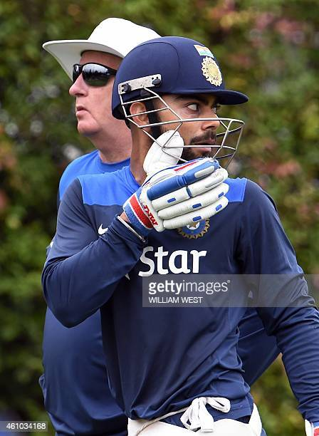 India's coach Duncan Fletcher and captain Virat Kohli stand together during cricket training at the Sydney Cricket Ground on January 5 2015 Australia...