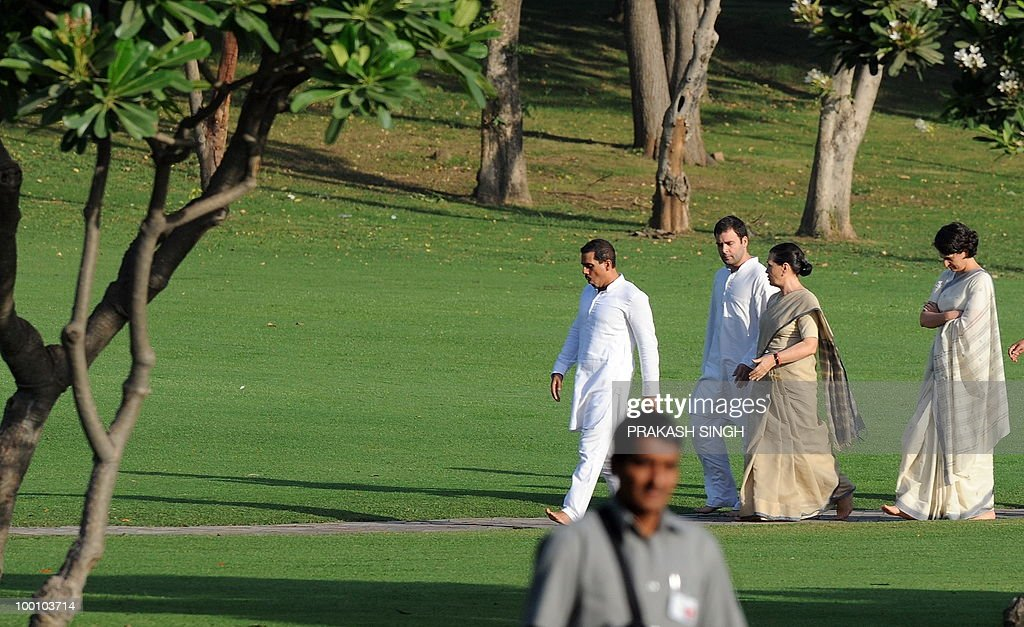 India's Congress Party President Sonia Gandhi (2R), her daughter Priyanka Gandhi (R), her son Rahul Gandhi (2L) and husband of Priyanka, Robert Vadra (L) walk to a memorial ceremony for slain former Indian prime minister Rajiv Gandhi on his 19th death anniversary, in New Delhi on May 21, 2010. Rajiv Gandhi was assasinated during electoral campaigning, allegedly by Liberation Tigers of Tamil Eelam (LTTE) rebel separatists, in the town of Sriperumpudur in the southern state of Tamil Nadu on May 21, 1991. AFP PHOTO / Prakash SINGH