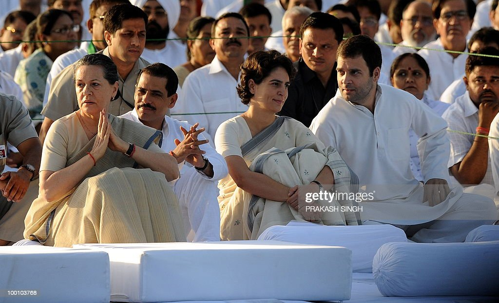 India's Congress Party President Sonia Gandhi (L), her daughter Priyanka Gandhi (3L), her son Rahul Gandhi (4L) and husband of Priyanka, Robert Vadra (2L) attend a memorial ceremony for slain former Indian prime minister Rajiv Gandhi on his 19th death anniversary, in New Delhi on May 21, 2010. Rajiv Gandhi was assasinated during electoral campaigning, allegedly by Liberation Tigers of Tamil Eelam (LTTE) rebel separatists, in the town of Sriperumpudur in the southern state of Tamil Nadu on May 21, 1991. AFP PHOTO / Prakash SINGH