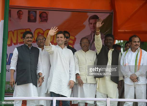 India's Congress Party Vice President Rahul Gandhi waves to party supporters during a rally as he stands with the nominated Congress party candidates...