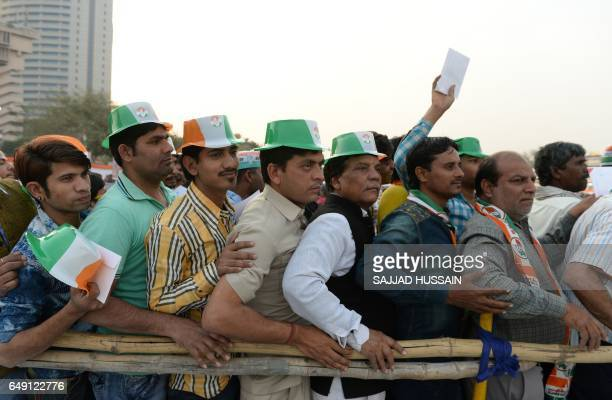 TOPSHOT India's Congress Party workers and supporters wait for a speech by the party's vicepresident Rahul Gandhi at a rally in New Delhi on March 7...