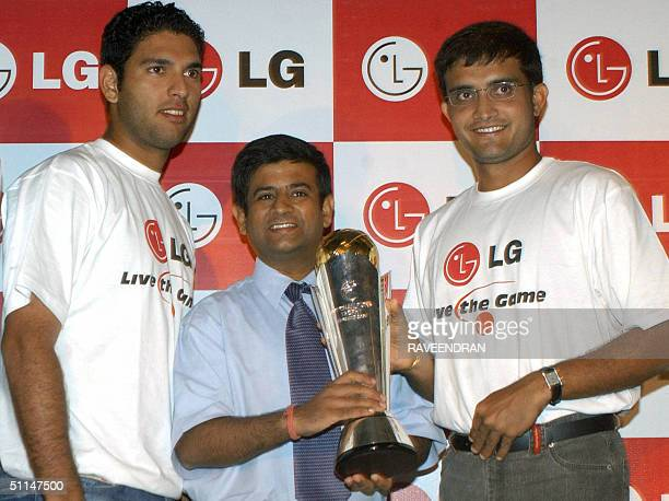 India's cricket captain Sourav Ganguly and team player Yuvraj Singh pose with LG Electronics India Marketing Head Salil Kapoor as they hold The ICC...
