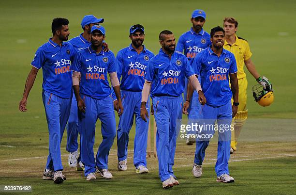 India's cricketers leave the field at the end of the T20 cricket match between India and a Western Australian XI in Perth on January 8 2016 AFP PHOTO...
