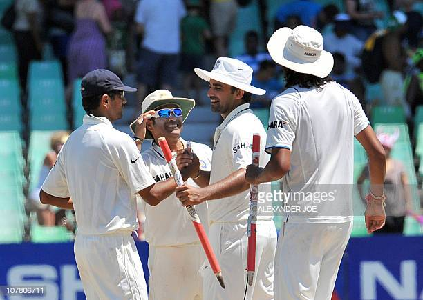 India's cricketers Rahul Dravid Sachin Tendulkar Zaheer Khan and Ishant Sharma celebrate their victory on the fourth day of the second Test between...