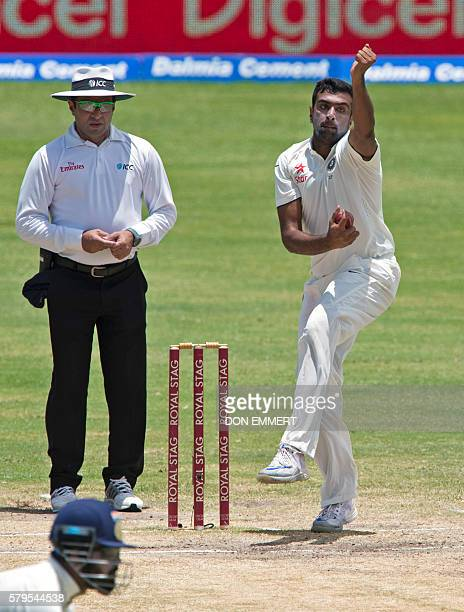 India's cricketers Ravichandran Ashwin bowls during day four of the cricket test match between West Indies and India July 24 2016 at Sir Vivian...