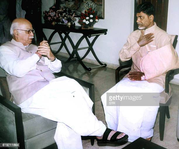 India's Deputy Prime Minister Lal Krishna Advani speaks to Cheif Minister for the Indian state of Andhra Pradesh N Chandrababu Naidu in Hyderabad 03...