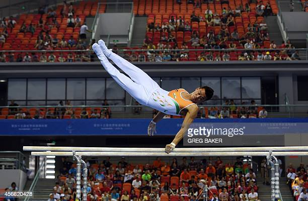 India's Dhan Bahadur competes on the parallel bars during the men's qualification at the Gymnastics World Championships in Nanning in China's...