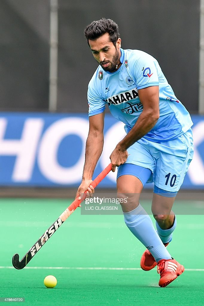 India's <a gi-track='captionPersonalityLinkClicked' href=/galleries/search?phrase=Dharamvir+Singh+-+Field+Hockey+Player&family=editorial&specificpeople=16041870 ng-click='$event.stopPropagation()'>Dharamvir Singh</a> controls the ball during the field hockey match between Pakistan and India in the men's Group A of the World League semi-final, in Brasschaat,on June 26, 2015.