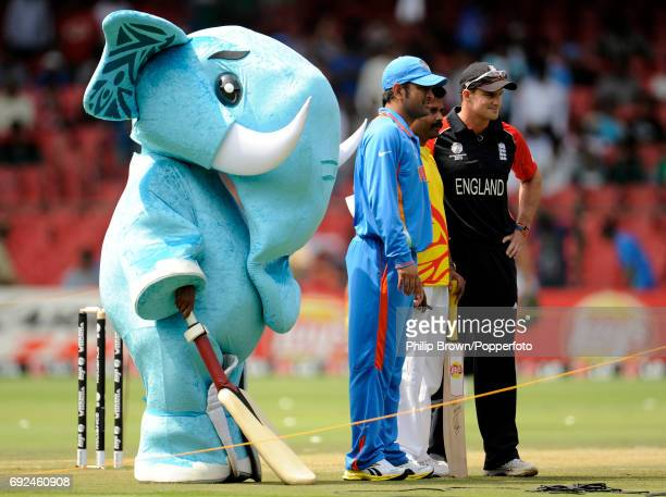 India's MS Dhoni and Andrew Strauss line up with the tournament mascot 'Stumpy' before the ICC Cricket World Cup group B match in Bangalore on...