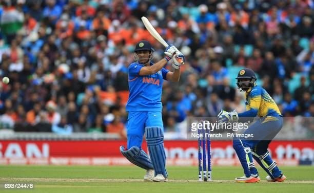 India's MS Dhoni and Sri Lanks's Niroshan Dickwella during the ICC Champions Trophy Group B match at The Oval London