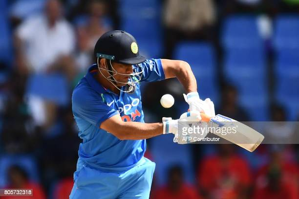 India's MS Dhoni plays a shot during the fourth One Day International match between West Indies and India at the Sir Vivian Richards Cricket Ground...