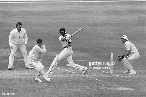 India's Dilip Vengsarkar pulls the ball over the head of England's Derek Randall watched by England's Bob Taylor and Ian Botham