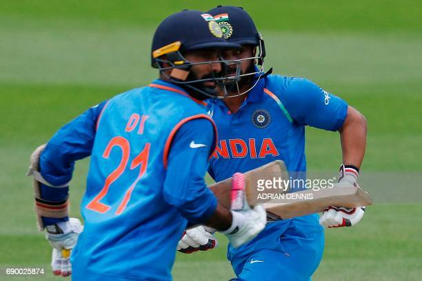 India's Dinesh Karthik ansd India's Kedar Jadhav add runs during the ICC Champions Trophy Warmup cricket match between India and Bangladesh at The...