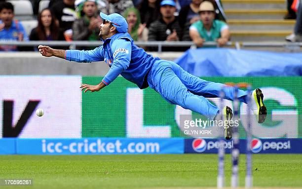 India's Dinesh Karthik misses a catch during the 2013 ICC Champions Trophy cricket match between Pakistan and India at Edgbaston in Birmingham...